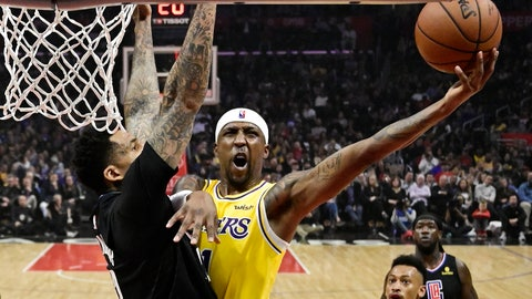 <p>               Los Angeles Lakers guard Kentavious Caldwell-Pope shoots as Los Angeles Clippers forward Wilson Chandler defends during the first half of an NBA basketball game Friday, April 5, 2019, in Los Angeles. (AP Photo/Mark J. Terrill)             </p>