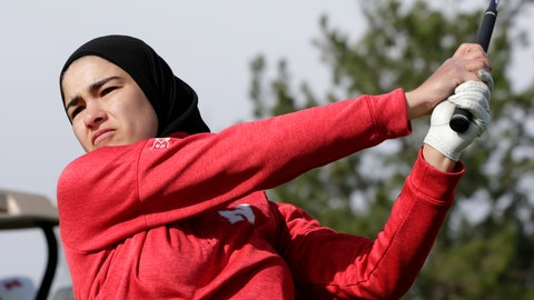 <p>               In this April 10, 2019 photo, Noor Ahmed, a member of the Nebraska NCAA college golf team, watches her shot during practice in Lincoln, Neb. Ahmed is the only golfer at the college level or higher known to wear a hijab while competing. She hopes Muslim girls are watching her and encouraged to chase their dreams in environments where they might encounter fear, uncertainty and hostility. (AP Photo/Nati Harnik)             </p>