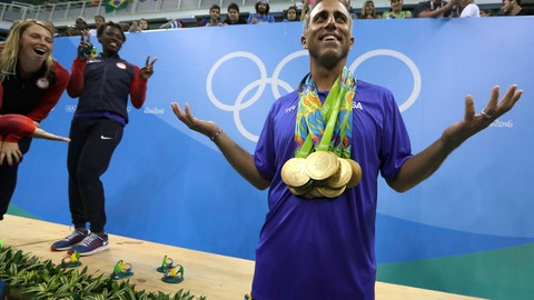 <p>               FILE - In this Friday, Aug. 19, 2016, file photo, United States' women's water polo head coach Adam Krikorian poses for photographers during the medals ceremony at the Summer Olympics in Rio de Janeiro, Brazil. Krikorian coached the U.S. to the 2009 world title. (AP Photo/Sergei Grits, File)             </p>