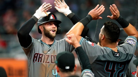 <p>               Arizona Diamondbacks' Christian Walker, left, celebrates as he returns to the dugout after hitting a solo-home run in the ninth inning of a baseball game against the Atlanta Braves, Tuesday, April 16, 2019, in Atlanta. (AP Photo/John Bazemore)             </p>