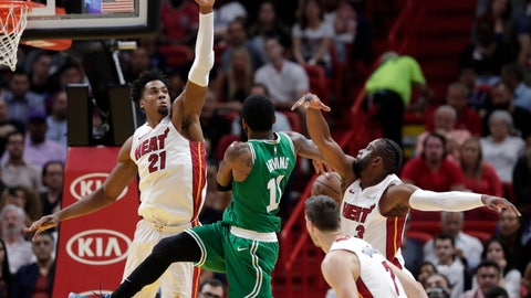 <p>               Boston Celtics guard Kyrie Irving (11) loses the ball as Miami Heat center Hassan Whiteside (21) and guard Dwyane Wade (3) defend during the first half of an NBA basketball game Wednesday, April 3, 2019, in Miami. (AP Photo/Lynne Sladky)             </p>