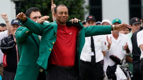 <p>               Patrick Reed helps Tiger Woods with his green jacket after Woods won the Masters golf tournament Sunday, April 14, 2019, in Augusta, Ga. (AP Photo/David J. Phillip)             </p>
