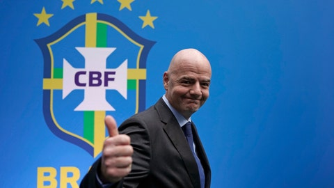 <p>               FIFA President Gianni Infantino gives a thumbs up after speaking to the press at the swearing-in ceremony of Rogerio Caboclo as president of the Brazilian Football Confederation in Rio de Janeiro, Brazil, Tuesday, April 9, 2019. The biggest challenges for Caboclo will be ending Brazil's World Cup title drought, dating back to 2002, improving the country's youth teams and moving the national governing body away from scandal. (AP Photo/Leo Correa)             </p>