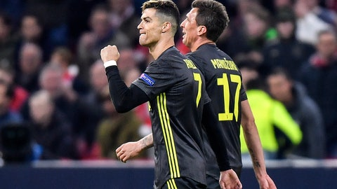 <p>               Juventus' Cristiano Ronaldo, left, celebrates after scoring his side's opening goal during the Champions League quarterfinal, first leg, soccer match between Ajax and Juventus at the Johan Cruyff ArenA in Amsterdam, Netherlands, Wednesday, April 10, 2019. (AP Photo/Martin Meissner)             </p>