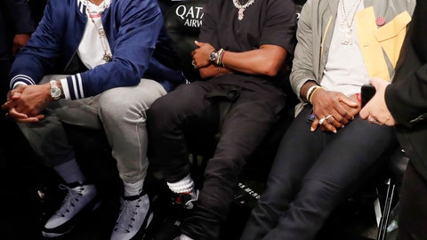 <p>               Carmelo Anthony, Chris Paul and LeBron James, from left, watch during the first half of an NBA basketball game between the Brooklyn Nets and the Miami Heat, Wednesday, April 10, 2019, in New York. The three were watching Miami Heat guard Dwyane Wade play the final NBA game of his career. (AP Photo/Kathy Willens)             </p>