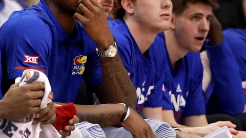 """<p>               FILE - In this Jan. 14, 2019, file photo, Kansas' Silvio De Sousa, left, watches from the bench during the first half of an NCAA college basketball game against Texas, in Lawrence, Kan. Kansas has officially appealed the NCAA's two-year suspension of forward Silvio De Sousa that resulted from an FBI probe into corruption in college basketball. The university said Thursday, Apirl 18, 2019, that De Sousa was suspended for most of the 2018-19 basketball season and all of the 2019-20 season """"for alleged violations that he was unaware of and from which he did not benefit."""" The school said it would have no further comment. (AP Photo/Charlie Riedel, File)             </p>"""