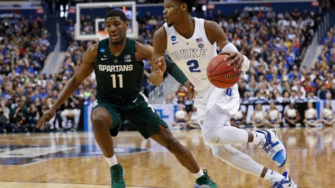<p>               Duke forward Cam Reddish (2) drives around Michigan State forward Aaron Henry (11) during the first half of an NCAA men's East Regional final college basketball game in Washington, Sunday, March 31, 2019. (AP Photo/Patrick Semansky)             </p>