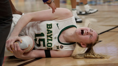 <p>               Baylor forward Lauren Cox yells as she holds her left knee, during the second half against Notre Dame in the Final Four championship game of the NCAA women's college basketball tournament Sunday, April 7, 2019, in Tampa, Fla. (AP Photo/John Raoux)             </p>