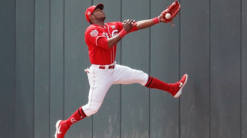 <p>               Cincinnati Reds right fielder Yasiel Puig catches out Miami Marlins' Curtis Granderson in the first inning of a baseball game, Thursday, April 11, 2019, in Cincinnati. (AP Photo/John Minchillo)             </p>