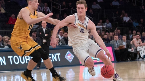 <p>               Lipscomb guard Jake Wolfe, right, drives to the basket against Wichita State guard Erik Stevenson during the first half of a semifinal college basketball game in the National Invitational Tournament, Tuesday, April 2, 2019, at Madison Square Garden in New York. (AP Photo/Mary Altaffer)             </p>