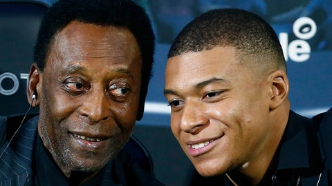 <p>               Brazilian soccer legend Pele, left, and French soccer player Kylian Mbappe pose during a photocall in Paris, Tuesday, April 2, 2019. (AP Photo)             </p>