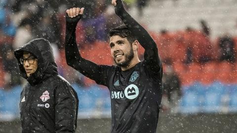 <p>               In the rain, Toronto FC midfielder Alejandro Pozuelo (10) celebrates after defeating Minnesota United in MLS soccer match action in Toronto, Friday, April 19, 2019. (Christopher Katsarov/The Canadian Press via AP)             </p>