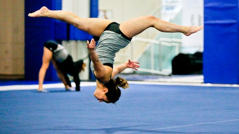 """<p>               In this Thursday, April 11, 2019, photo, UCLA gymnast Katelyn Ohashi trains on the floor with the University of California Bruins gymnastics team in Los Angeles.  Ohashi is a social media darling with three viral floor routines and according to coach Valorie Kondos Field """"a better person, teammate and gymnast."""" As Ohashi gets ready to compete in her final collegiate meet, she says she is happy to be walking away on her own terms and is looking to the future after graduating in June. (AP Photo/Damian Dovarganes)             </p>"""