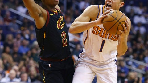 <p>               Phoenix Suns guard Devin Booker (1) gets fouled by Cleveland Cavaliers guard Collin Sexton (2) as Booker goes up for a shot during the second half of an NBA basketball game, Monday, April 1, 2019, in Phoenix. The Suns defeated the Cavaliers 122-113. (AP Photo/Ross D. Franklin)             </p>