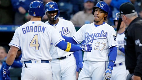<p>               Kansas City Royals' Alex Gordon (4) is congratulated at home plate by Jorge Soler (12) and Adalberto Mondesi (27) after hitting a two-run home run in the first inning of a baseball game against the Cleveland Indians at Kauffman Stadium in Kansas City, Mo., Friday, April 12, 2019. (AP Photo/Colin E. Braley)             </p>