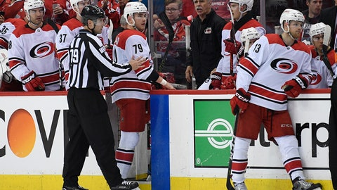 <p>               Carolina Hurricanes left wing Micheal Ferland (79) is shown to the bench by linesman Kiel Murchison (79) after he received a match penalty for a hit to the head of Washington Capitals' Nic Dowd, not seen, during the second period of Game 2 of an NHL hockey first-round playoff series, Saturday, April 13, 2019, in Washington. The Capitals won 4-3 in overtime. (AP Photo/Nick Wass)             </p>