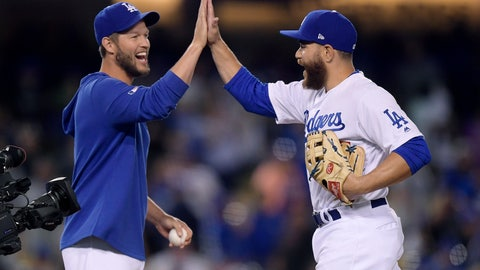 <p>               Los Angeles Dodgers' Russell Martin, whose normal position is catcher, is congratulated by Clayton Kershaw after closing out the team's baseball game against the Arizona Diamondbacks on Saturday, March 30, 2019, in Los Angeles. (AP Photo/Mark J. Terrill)             </p>