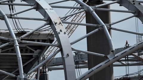 <p>               A construction worker stands amidst the towering roof over the new NFL Los Angeles Stadium while under construction in Inglewood, Calif. on Monday April 15, 2019. Stadium officials hosted a tour for the media after the final piece of the canopy structure to hold the roof was completed. (AP Photo/Richard Vogel)             </p>