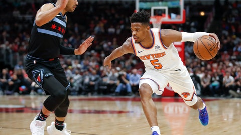 <p>               New York Knicks guard Dennis Smith Jr. (5) drives to the basket against Chicago Bulls guard Timothe Luwawu-Cabarrot during the first half of an NBA basketball game Tuesday, April 9, 2019, in Chicago. (AP Photo/Kamil Krzaczynski)             </p>