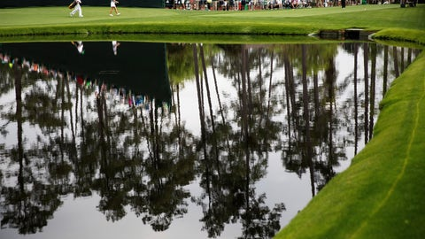 <p>               Jennifer Kupcho, right, and her caddie Brian McKinley, walks past a pond to tee off the 16th hole in the final round of the Augusta National Women's Amateur golf tournament in Augusta, Ga., Saturday, April 6, 2019. (AP Photo/David Goldman)             </p>