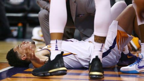 <p>               An injured Phoenix Suns guard Devin Booker pauses on the floor after turning his ankle during the first half of the team's NBA basketball against the Utah Jazz Wednesday, April 3, 2019, in Phoenix. Booker left the game. (AP Photo/Ross D. Franklin)             </p>