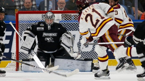 <p>               Minnesota Duluth forward Noah Cates (21) takes a shot on Providence goalie Hayden Hawkey (31) during the first period in the semifinal of the Frozen Four NCAA college hockey tournament, Thursday, April 11, 2019, in Buffalo, N.Y. (AP Photo/Jeffrey T. Barnes)             </p>