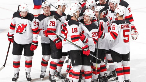 <p>               Teammates congratulate New Jersey Devils center Travis Zajac (19) after he scored the game winning goal against the Florida Panthers during the overtime period of an NHL hockey game, Saturday, April 6, 2019, in Sunrise, Fla. The Devils defeated the Panthers 4-3 in overtime. (AP Photo/Joel Auerbach)             </p>