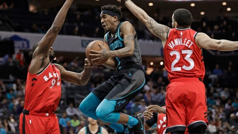 <p>               Charlotte Hornets' Malik Monk (1) drives between Toronto Raptors' Fred VanVleet (23) and Serge Ibaka (9) during the first half of an NBA basketball game in Charlotte, N.C., Friday, April 5, 2019. (AP Photo/Chuck Burton)             </p>