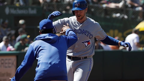 <p>               Toronto Blue Jays' Justin Smoak, right, is congratulated by a teammate after hitting a two-run home run against the Oakland Athletics during the seventh inning of a baseball game in Oakland, Calif., Sunday, April 21, 2019. (AP Photo/Jeff Chiu)             </p>