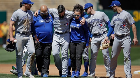 <p>               Toronto Blue Jays pitcher Matt Shoemaker, third from left, is helped off the field after sustaining an injury on a rundown play against the Oakland Athletics in the third inning of a baseball game Saturday, April 20, 2019, in Oakland, Calif. (AP Photo/Ben Margot)             </p>