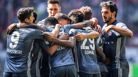 <p>               Bayern's Kingsley Coman is celebrated by his team after scoring during the German Bundesliga soccer match between Fortuna Duesseldorf and Bayern Munich in Duesseldorf, Germany, Sunday April 14, 2019. (AP Photo/Martin Meissner)             </p>