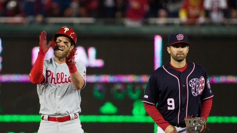 <p>               Philadelphia Phillies' Bryce Harper, left, celebrates his RBI hit while on second base with Washington Nationals second baseman Brian Dozier during the sixth inning of a baseball game at Nationals Park, Tuesday, April 2, 2019, in Washington. (AP Photo/Alex Brandon)             </p>