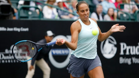 <p>               Madison Keys returns a shot to Monica Puig, from Puerto Rico, during their semifinal at the Volvo Car Open in Charleston, S.C., Saturday, April 6, 2019. (AP Photo/Mic Smith)             </p>