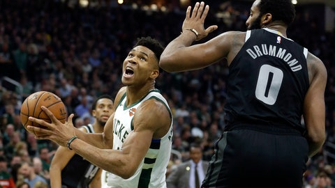 <p>               Milwaukee Bucks' Giannis Antetokounmpo drives to the basket against Detroit Pistons' Andre Drummond during the second half of Game 2 of an NBA basketball first-round playoff series Wednesday, April 17, 2019, in Milwaukee. The Bucks won 120-99. (AP Photo/Aaron Gash)             </p>