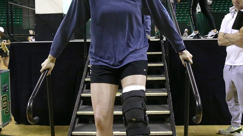 <p>               Baylor's Lauren Cox exits the stage after a welcome home celebration for the NCAA Division I women's basketball champions inside the Ferrell Center, Monday April 8, 2019, in Waco, Texas. (Jerry Larson/Waco Tribune Herald via AP)             </p>