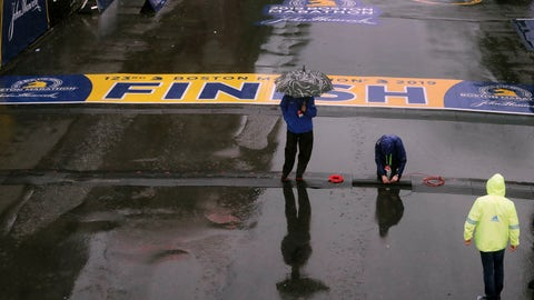 <p>               Final preparations are made in the rain at the finish line for the 123rd Boston Marathon on Monday, April 15, 2019, in Boston. (AP Photo/Charles Krupa)             </p>