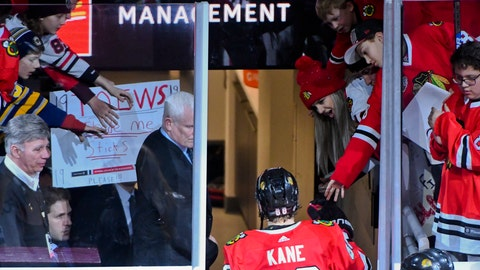 <p>               Chicago Blackhawks right wing Patrick Kane (88) is greeted by fans after an NHL hockey game against the Dallas Stars on Friday, April 5, 2019, in Chicago. (AP Photo/Matt Marton)             </p>