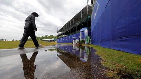 <p>               A person walks on the largely empty course during a weather delay for the first round of the PGA Zurich Classic golf tournament at TPC Louisiana in Avondale, La., Thursday, April 25, 2019. (AP Photo/Gerald Herbert)             </p>