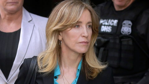 <p>               FILE - In this April 3, 2019 file photo, actress Felicity Huffman arrives at federal court in Boston to face charges in a nationwide college admissions bribery scandal. In a court filing on Monday, April 8, 2019, Huffman agreed to plead guilty in the cheating scam. (AP Photo/Steven Senne, File)             </p>
