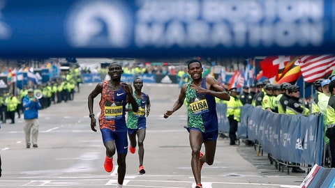 <p>               Lawrence Cherono, left, of Kenya, runs to the finish line to win the 123rd Boston Marathon in front of Lelisa Desisa, of Ethiopia, right, on Monday, April 15, 2019, in Boston. (AP Photo/Winslow Townson)             </p>