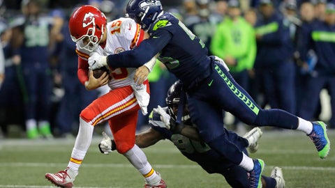<p>               FILE - In this Dec. 23, 2018, file photo, Kansas City Chiefs quarterback Patrick Mahomes (15) is tackled by Seattle Seahawks defensive end Frank Clark, right, during the second half of an NFL football game, in Seattle. The Kansas City Chiefs have agreed to acquire defensive end Frank Clark from the Seattle Seahawks in exchange for a first-round draft pick this year and a second-round pick in 2020. Almost immediately after word leaked of the trade on Tuesday, April 23, 2019, Clark and the Chiefs worked quickly to reach agreement on a five-year contract worth up to $105 million, according to a person with knowledge of the deal. The person spoke to The Associated Press on the condition of anonymity because the deal had not been announced by either team and was still pending a physical. (AP Photo/Stephen Brashear, File)             </p>