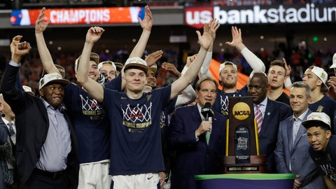 <p>               Virginia players celebrate with the championship trophy after defeating Texas Tech 85-77 in the overtime in the championship of the Final Four NCAA college basketball tournament, Monday, April 8, 2019, in Minneapolis. (AP Photo/David J. Phillip)             </p>