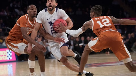 <p>               TCU guard Alex Robinson (25) drives to the basket against Texas guard Kerwin Roach II (12) and guard Matt Coleman III during the first half of a semifinal college basketball game in the National Invitational Tournament, Tuesday, April 2, 2019, at Madison Square Garden in New York. (AP Photo/Mary Altaffer)             </p>