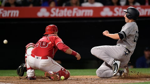 <p>               New York Yankees' Kyle Higashioka, right, scores on a sacrifice fly hit by Gleyber Torres as Los Angeles Angels catcher Jonathan Lucroy, left, loses the ball during the third inning of a baseball game Monday, April 22, 2019, in Anaheim, Calif. (AP Photo/Mark J. Terrill)             </p>