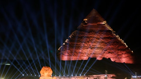 <p>               Lights illuminates the sky over the historical site of the Giza Pyramids and Sphinx to celebrate the African Cup of Nations draw in Cairo, Egypt, Friday, April 12, 2019. The tournament which will feature 24 teams will be held in Egypt in June 2019. (AP Photo/Amr Nabil)             </p>