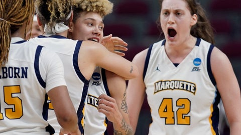 <p>               Marquette's Natisha Hiedeman, center right, is hugged by Selena Lott as Lauren Van Kleunen (42) and Amani Wilborn, left, help celebrate after Hiedeman's free throws during the closing seconds against Rice in overtime of a first round women's college basketball game in the NCAA Tournament Friday, March 22, 2019, in College Station, Texas. Marquette won 58-54 in overtime. (AP Photo/David J. Phillip)             </p>