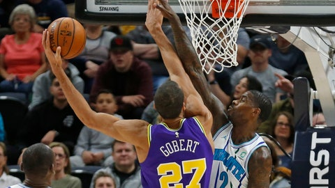 <p>               Charlotte Hornets forward Marvin Williams (2) defends against Utah Jazz center Rudy Gobert (27) during the first half of an NBA basketball game Monday, April 1, 2019, in Salt Lake City. (AP Photo/Rick Bowmer)             </p>