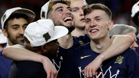 <p>               Virginia's Ty Jerome, center, and Kyle Guy, right, celebrate after defeating Texas Tech 85-77 in the overtime in the championship of the Final Four NCAA college basketball tournament, Monday, April 8, 2019, in Minneapolis. (AP Photo/David J. Phillip)             </p>