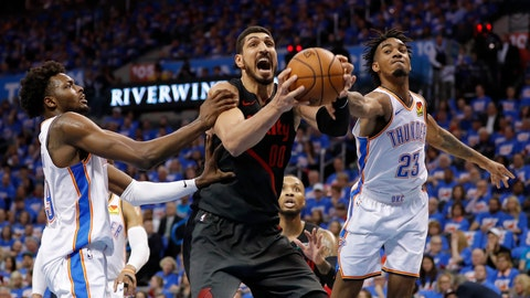 <p>               Portland Trail Blazers center Enes Kanter, center, Oklahoma City Thunder forward Jerami Grant, left, and guard Terrance Ferguson, right, compete for a rebound in the second half of Game 4 of an NBA basketball first-round playoff series Sunday, April 21, 2019, in Oklahoma City. Portland won 111-98. (AP Photo/Alonzo Adams)             </p>