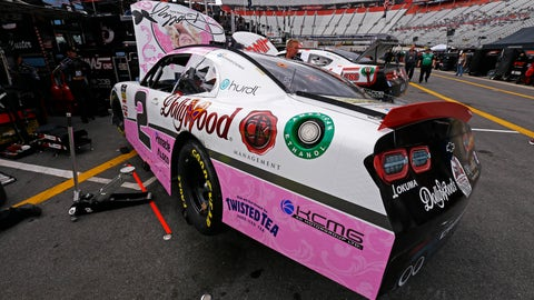 <p>               The car of driver Tyler Reddick sits in the pits being worked on after practice for the NASCAR Xfinity Series auto race Friday, April 5, 2019, in Bristol, Tenn. The reigning Xfinity Series champion is piloting a Chevrolet at Bristol covered with country music icon Dolly Parton's face and her signature butterfly logo.(AP Photo/Wade Payne)             </p>